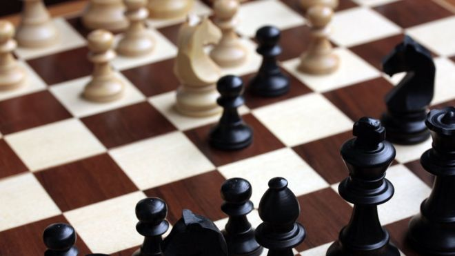 A close-up image of a chess board