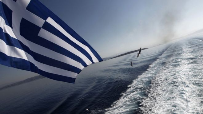 The Greek flag flying at the stern of a ship