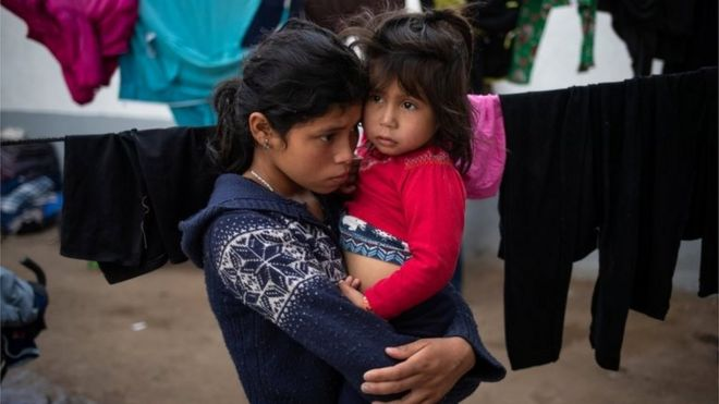 Sedalina, a 14 year old migrant girl from Guatemala, holds her four-year-old sister Nooresita as they take refuge in a shelter with a caravan from Central America trying to reach the United States, in Tijuana, Mexico November 20, 2018