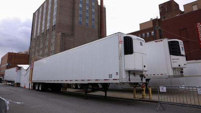 Refrigerated tractor trailers serve as temporary morgues outside the Wyckoff Heights Medical Center in the Brooklyn borough of New York City, New York, 10 April