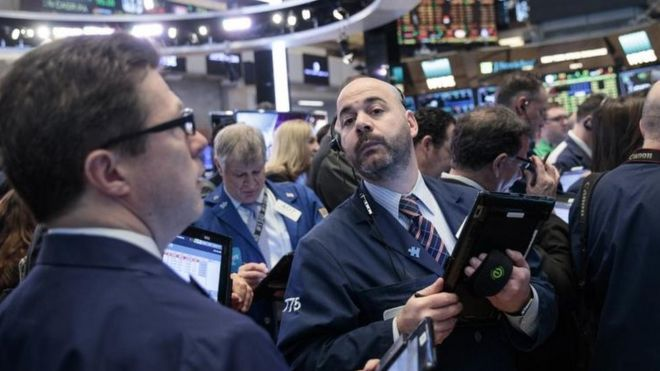 Wall Street holds steady with a boost from technology stocks