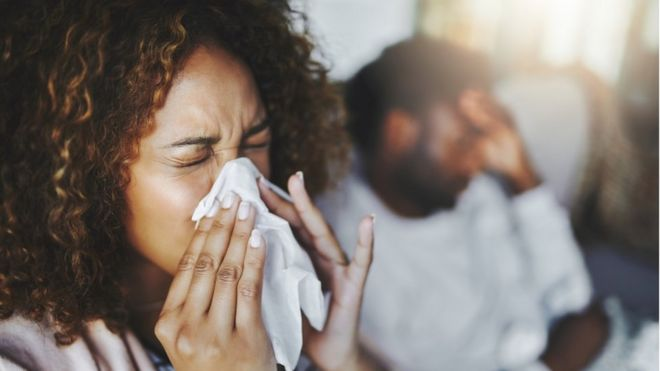 Should you leave the room when you cough or sneeze? - BBC News