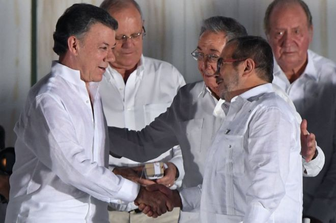 Colombian President Juan Manuel Santos and the Farc leader known as Timochenko shake hands in ceremony in Cartagena in September