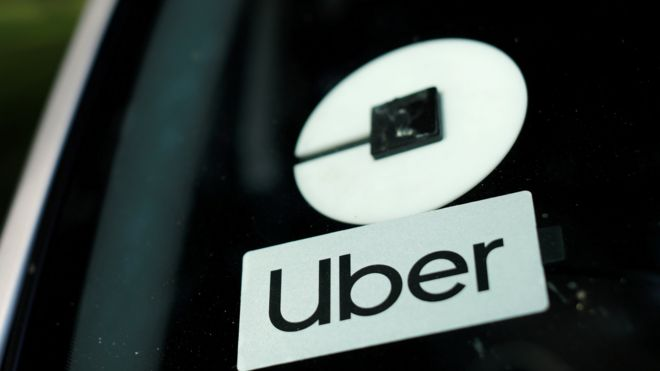 Uber logo in a car window