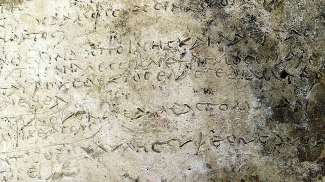 "A handout photo made available by the Greek Ministry of Culture shows a clay tablet with an engraved inscription of a rhapsody in Homer's ""Odyssey"" on 10 July 2018"
