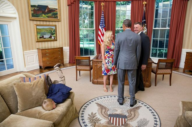 picture of oval office. a young boy faceplanting himself onto the sofa in oval office picture of