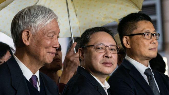 Ba người sáng lập Chiếm lĩnh Trung Hoàn, Cha Chu Yiu-ming, Giáo sư luật Benny Tai, Giáo sư Xã hội học Chan Kin-man