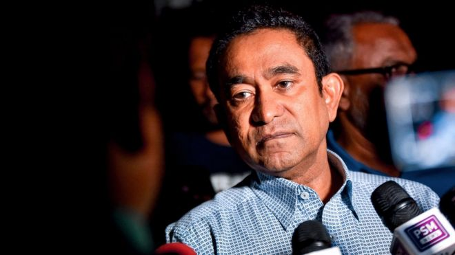 Maldives' former president Abdulla Yameen speaks to the media outside a police station where he had been questioned by investigators