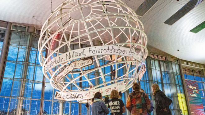 Activists occupy the globe in the lobby of the Volkswagen Autostadt in Wolfsburg, Germany, 13 August 2019