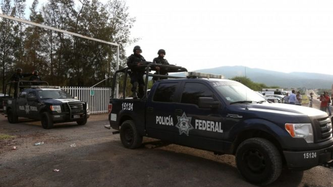 Federal Police leaving the ranch del Sol located in the municipality of Tanhuato, state of Michoacan, Mexico, after a confrontation which ended with 42 civilians and one police officer dead.