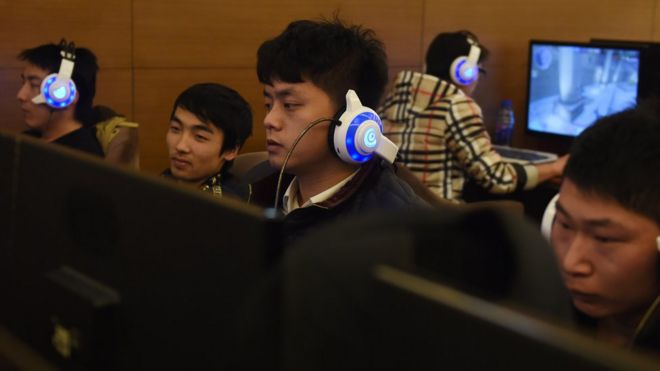 Men using computers in Beijing internet cafe, December 2015