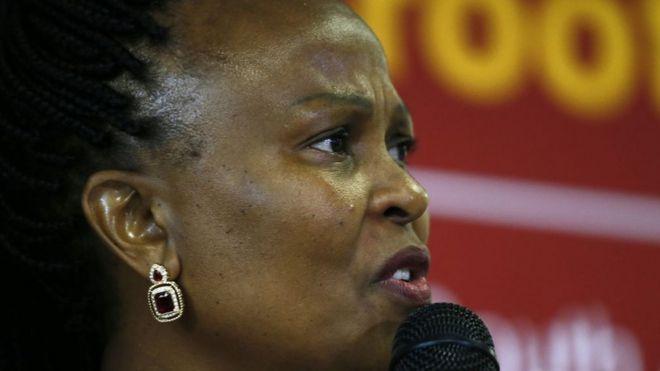 Busisiwe Mkhwebane speaks into a microphone.