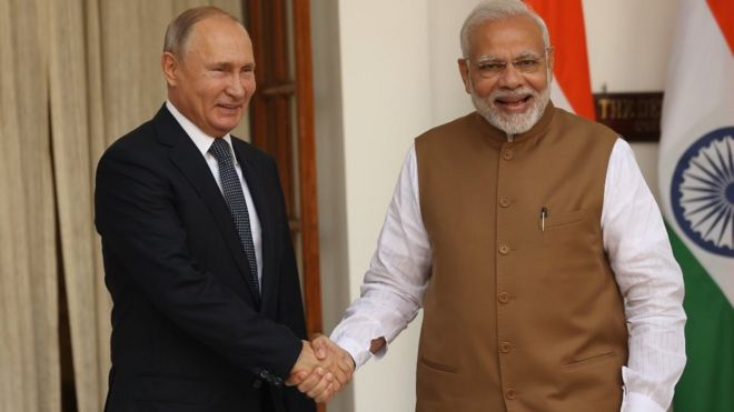 Indian Prime Minister Narendra Modi (R) greets Russian President Vladimir Putin (L) during a welcoming ceremony on October 5, 2018 in New Delhi, India. Vladimir Putin is on a two-day state visit to India.