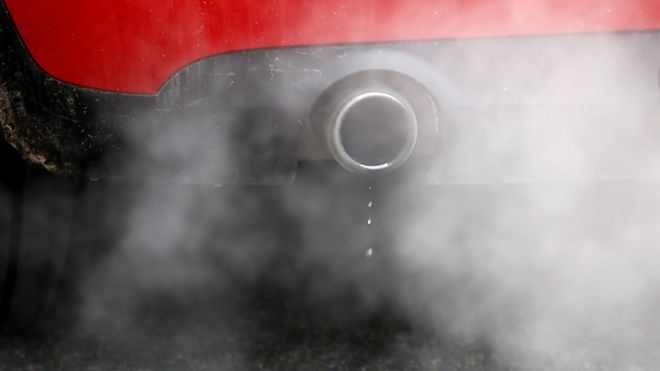 A car exhaust emits fumes