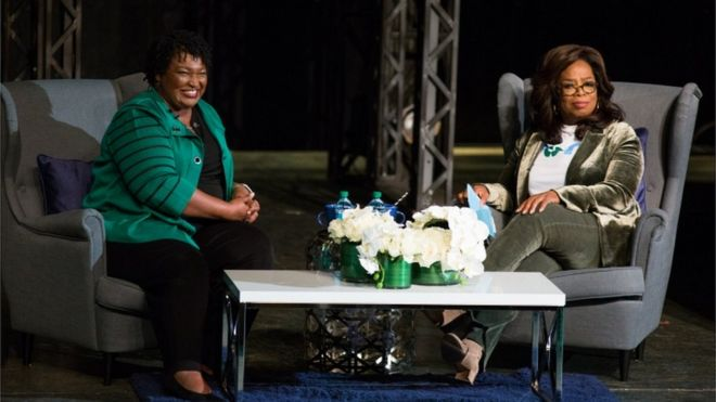 Oprah Winfrey and Stacey Abrams on stage