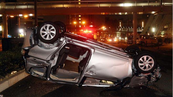 Overturned car in Osaka