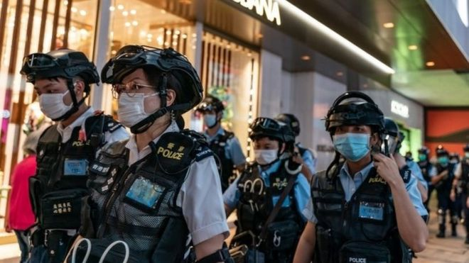 Riot 红茶的好处police wearing protective masks patrol during a demonstration outside a shopping mall in Hong Kong