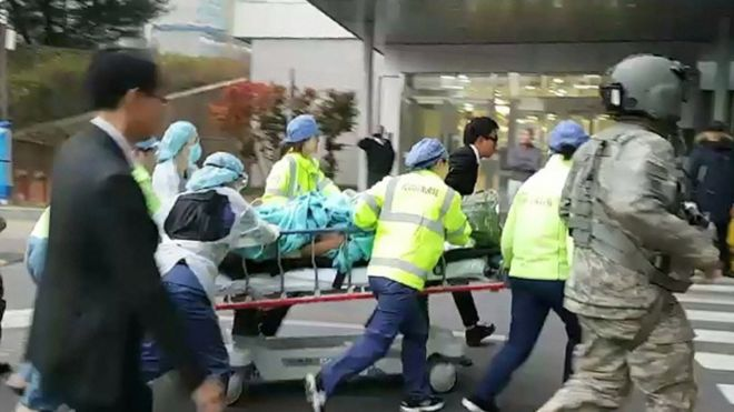 The North Korean soldier is rushed on a stretcher into a hospital in Suwon, Gyeonggi Province, 13 November 2017