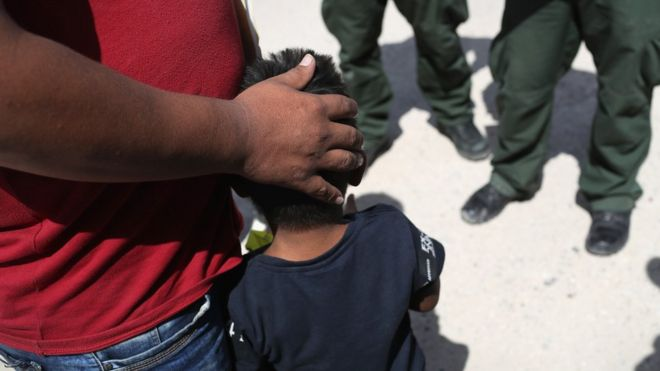A small boy from Honduras and his father are taken into custody by US Border Patrol agents near the US-Mexico Border on June 12, 2018 near Mission, Texas.