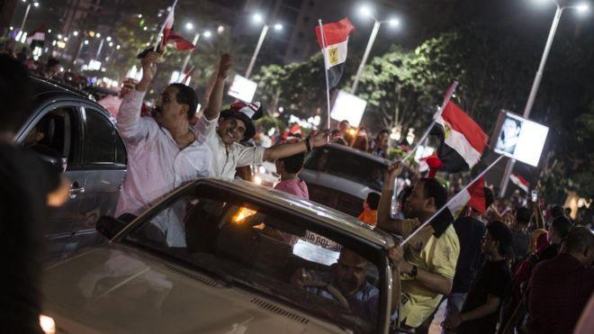 نتيجة بحث الصور عن احتفالات المصريين بتأهل لكأس العالم