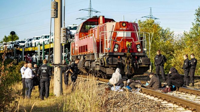 Environmentalists block railway tracks and stop a train loaded with new Volkswagen cars that has left the Volkswagen plant in Wolfsburg, northern Germany, on August 13, 2019