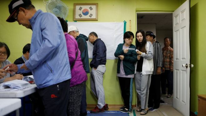 People cast their votes at a polling station during the presidential elections in Seoul, South Korea May 9, 2017