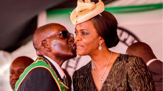President Robert Mugabe kisses his wife and first lady Grace Mugabe during during the country's 37th Independence Day celebrations at the National Sports Stadium in Harare April 2017