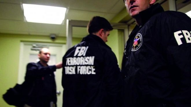 FBI Special Agents and members of the Joint Terrorism Task Force prepare to arrest a suspect