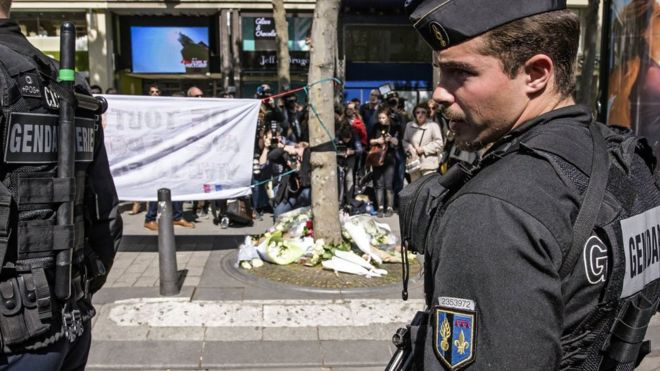 French officers pay tribute to officer killed on the Champs Elysees in Paris, 21 April 2017