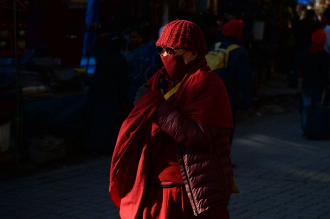 Monk in McLeod Ganj wearing mask