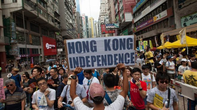 pro-Hong Kong independence activist carries a placard