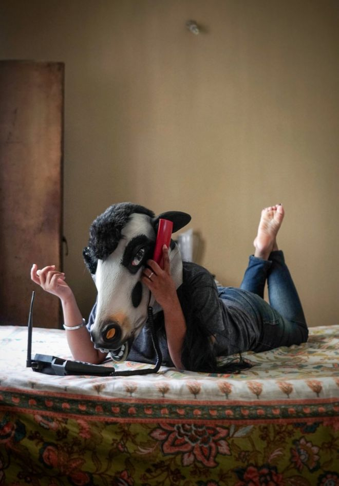 A woman with a cow mask