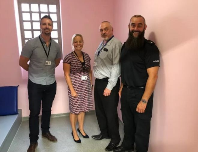 Pink jail cell with (l-r) Sgt Dave Williams, Supt Katy Barrow-Grint, former Ch Insp Dave Cherrington, Insp Dave Entwistle