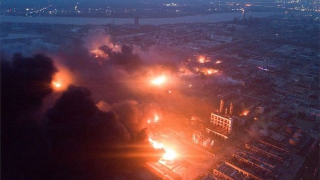 Overhead view of the Tianjiayi Chemical plant o­n fire with smoke billowing