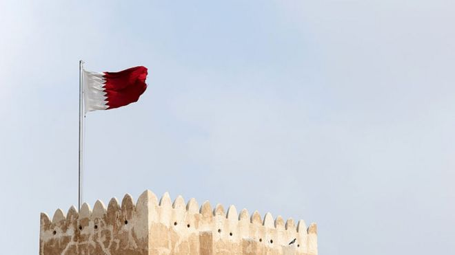 A Qatari flag flying over a Qatari fort 2016
