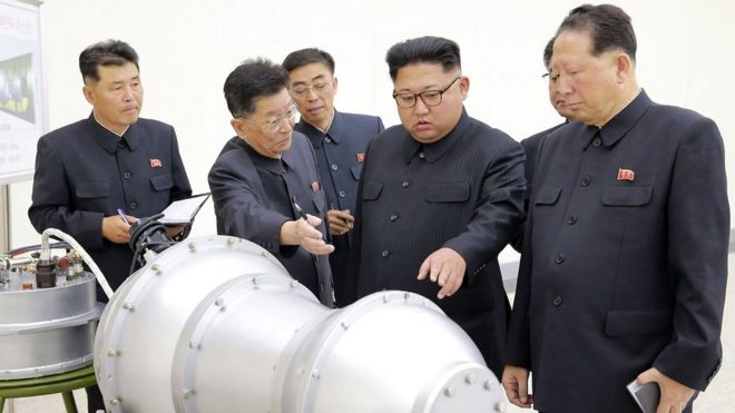 North Korean leader Kim Jong-un inspects a metal casing at an undisclosed location, 3 September 2017