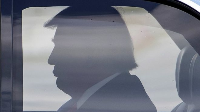 """US President Donald Trump sits in the presidential armoured state car known as """"The Beast"""" in Atlanta, Georgia, 15 July 2020"""