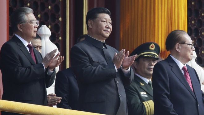 Chinese President Xi Jinping applauses next to former president Jiang Zemin