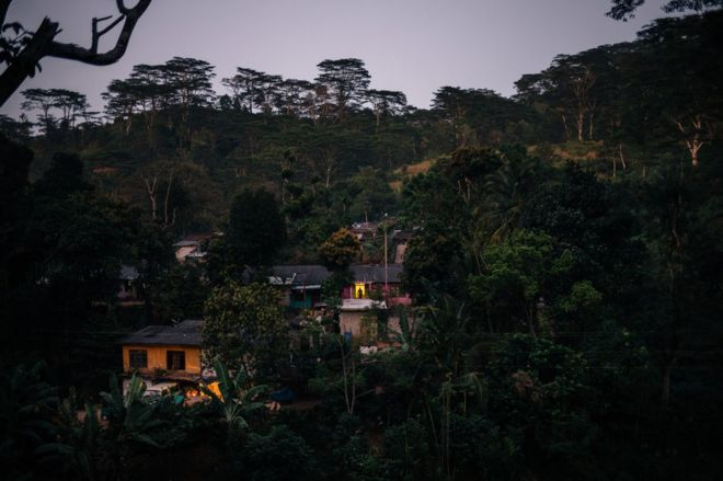 The sun sets over worker houses on a tea plantation near Kandy.