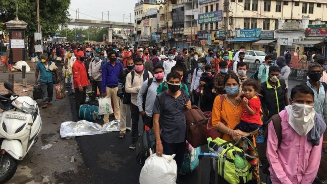 India coronavirus: Huge crowds as some train services resume