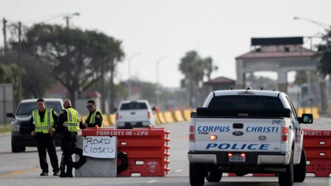 Police officers stand at a checkpoint after a shooting incident at Naval Air Station Corpus Christi, Texas, U.S. May 21, 2020