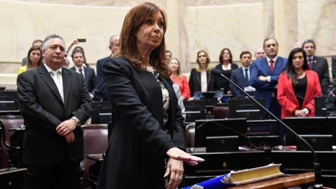 "Handout picture released by Argentina""s Senate press office showing Argentine former president and Buenos Aires senator Cristina Fernandez de Kirchner swearing-in for a new mandate as senator, at the Congress in Buenos Aires, on November 29, 2017."