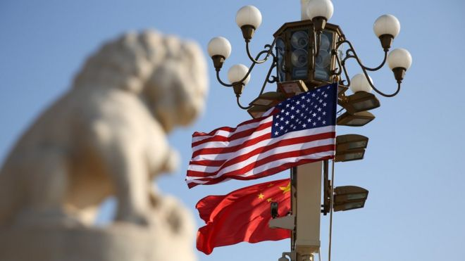 Chinese and American national flags fly on Tian'anmen Square to welcome U.S. President Donald Trump on November 8, 2017 in Beijing, China.