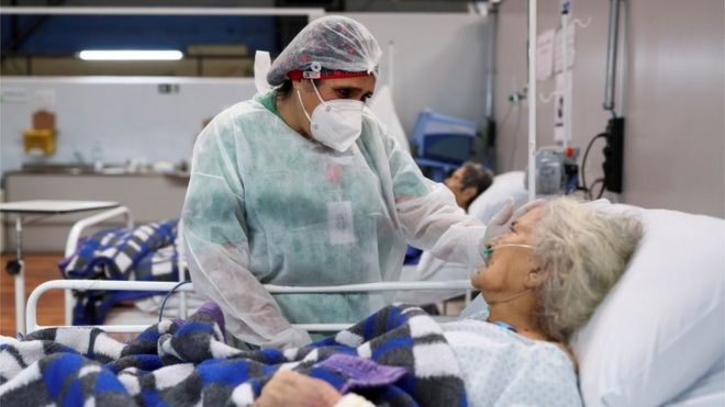 A nurse speaks to a Covid patient in Santo Andre, Sao Paulo state, Brazil, January 1, 2021