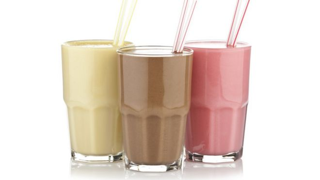 Glasses of different flavoured shakes