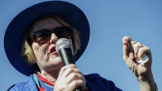 South African opposition party Democratic Alliance (DA) president Helen Zille addresses a crowd of supporters during an elections campaign rally in Johannesburg Alexandra township on 30 April, 2014.