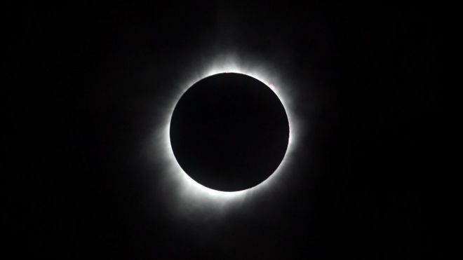 The sun is seen in full eclipse over a park on August 21, 2017 in Hiawatha, Kansas