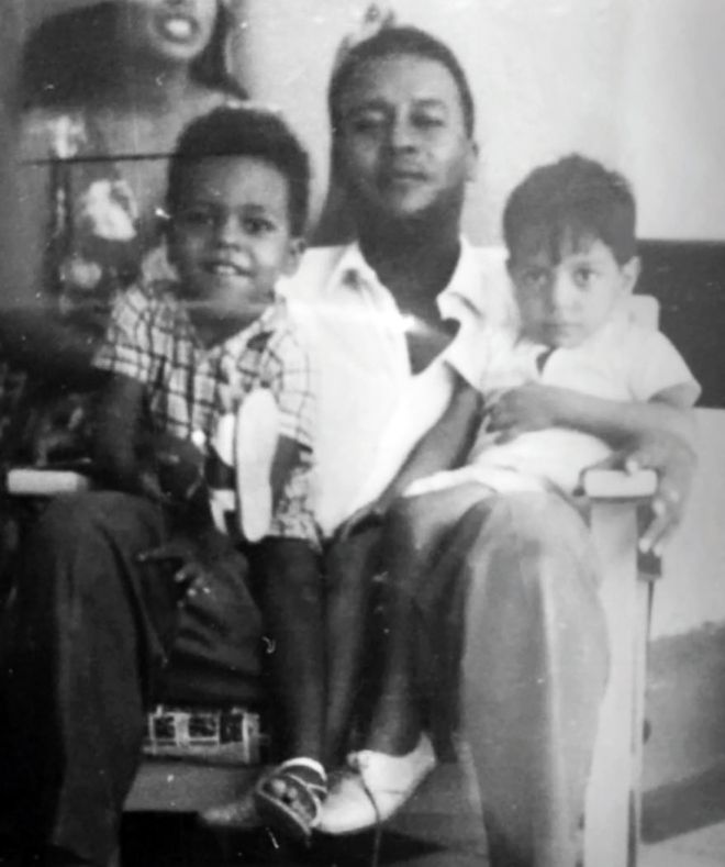 Amged El-Hawrani as a child - left, in checked shirt