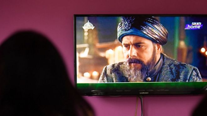 Woman watching the popular TV show Ertugrul