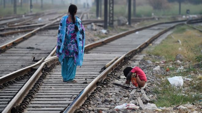 Representational image an Indian child defecating in the open
